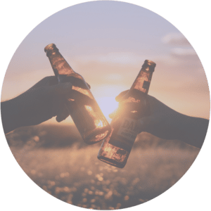 Two beer bottles at sunset